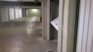 Cloisonnement d'un parking : porte basculante non débordante